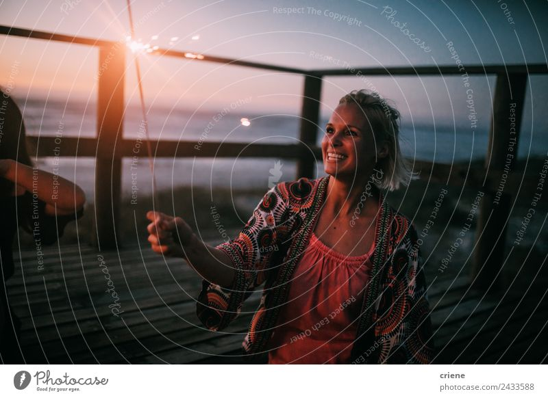 happy young adult woman holding sparkler by sunset at beach Lifestyle Joy Happy Beautiful Vacation & Travel Summer Sun Beach Ocean Woman Adults Nature Sky Coast