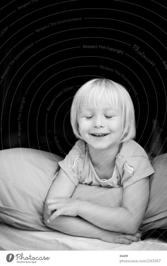 smile Joy Face Child Human being Toddler Girl 1 3 - 8 years Infancy Blonde Smiling Laughter Lie Cushion Small Cute Black & white photo Exterior shot