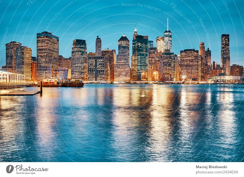 Manhattan skyline reflected in East River at dusk. Office Town Downtown Skyline High-rise Building Architecture Exceptional Elegant Success Blue Business