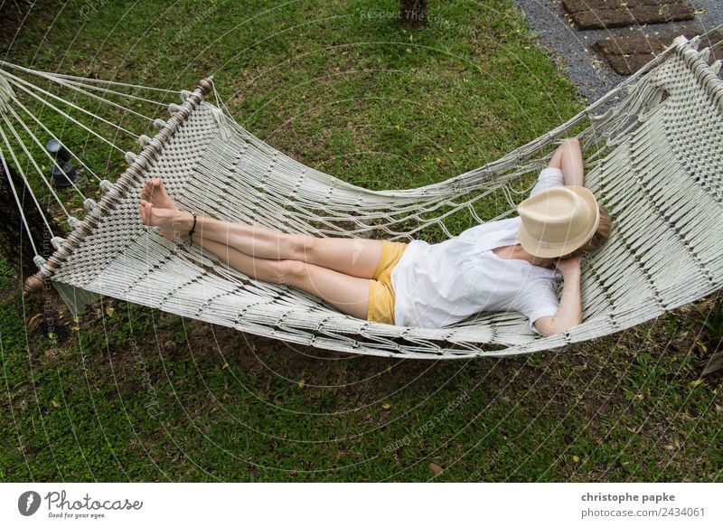 too hot Harmonious Well-being Contentment Senses Relaxation Calm Tourism Summer vacation Young woman Youth (Young adults) 1 Human being Lie Sleep Hammock Hat