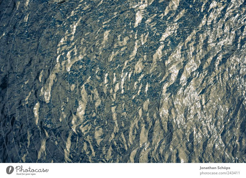 crumpled surface, cold underneath Water Waves Lake River Blue Wet Cold Damp Reflection Surface Surface structure Exterior shot Bird's-eye view Flat Simple