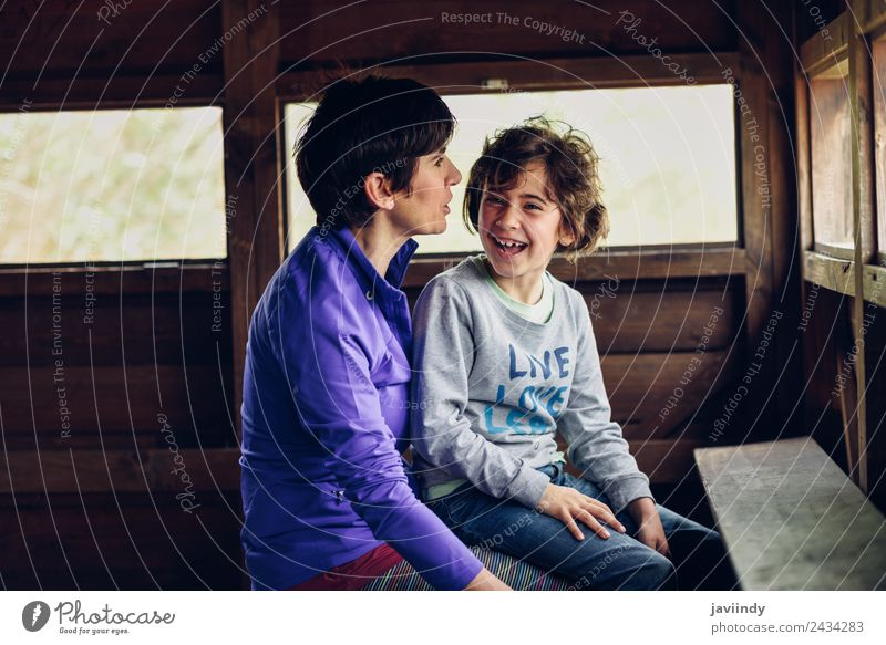 Mother and daughter laughing in a cabin Woman Child Human being White Joy Girl Adults Lifestyle Love Emotions Feminine Wood Family & Relations Laughter Small