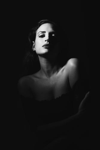 Young woman in black lingerie in chiaroscuro lighting. Elegant Style Beautiful Body Skin Face Make-up Feminine Youth (Young adults) Woman Adults 1 Human being