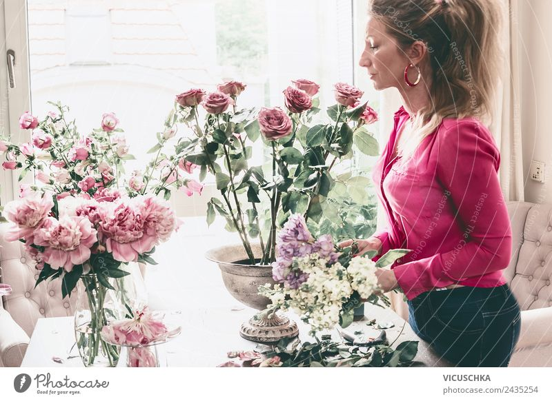 Woman arranges flower bouquet with roses in vase Lifestyle Luxury Style Design Leisure and hobbies Flat (apartment) Interior design Decoration Living room Party