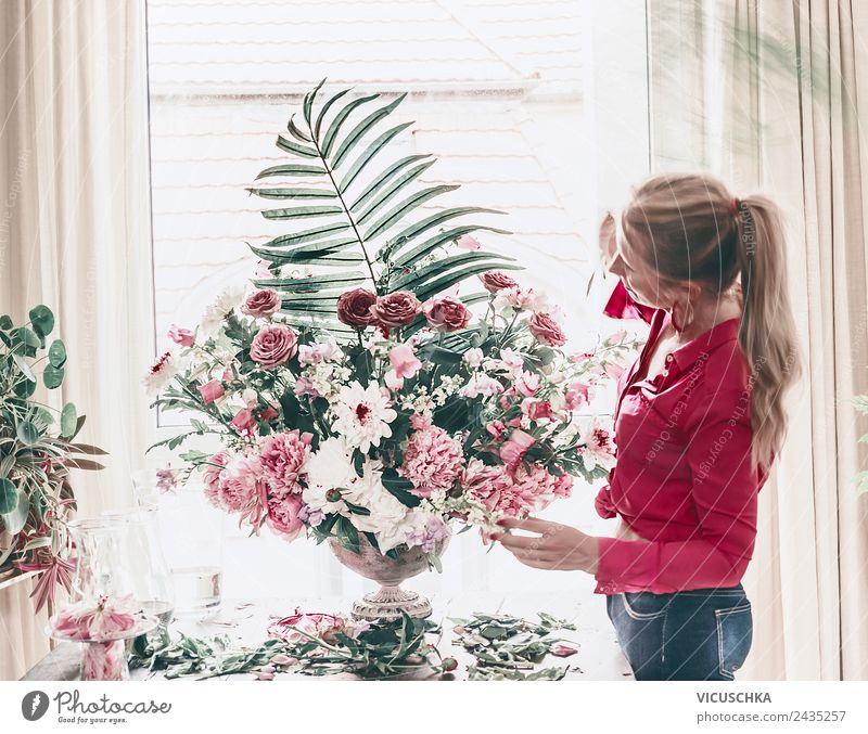 Florist woman arranges festive bouquet of flowers Lifestyle Style Beautiful Decoration Party Event Feasts & Celebrations Human being Woman Adults Plant Flower