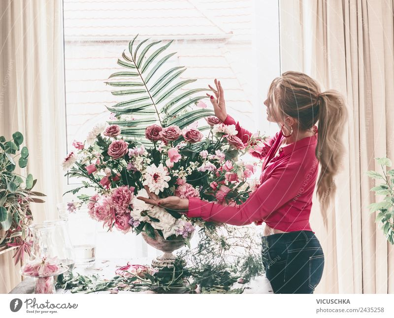 Woman arranges luxury bouquet of flowers Lifestyle Luxury Style Design Leisure and hobbies Living or residing Interior design Decoration Room Entertainment