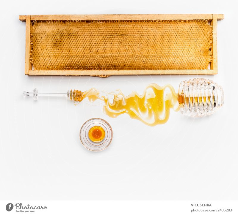 Honeycomb in a wooden frame with honey in a jar Food Nutrition Organic produce Vegetarian diet Diet Style Design Healthy Healthy Eating Honey-comb Cast Glass