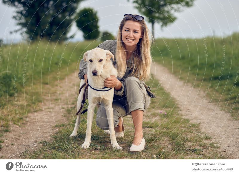 Happy young blond woman with her dog Woman Human being Nature Dog Youth (Young adults) Summer Beautiful Animal 18 - 30 years Face Street Adults Lifestyle Love