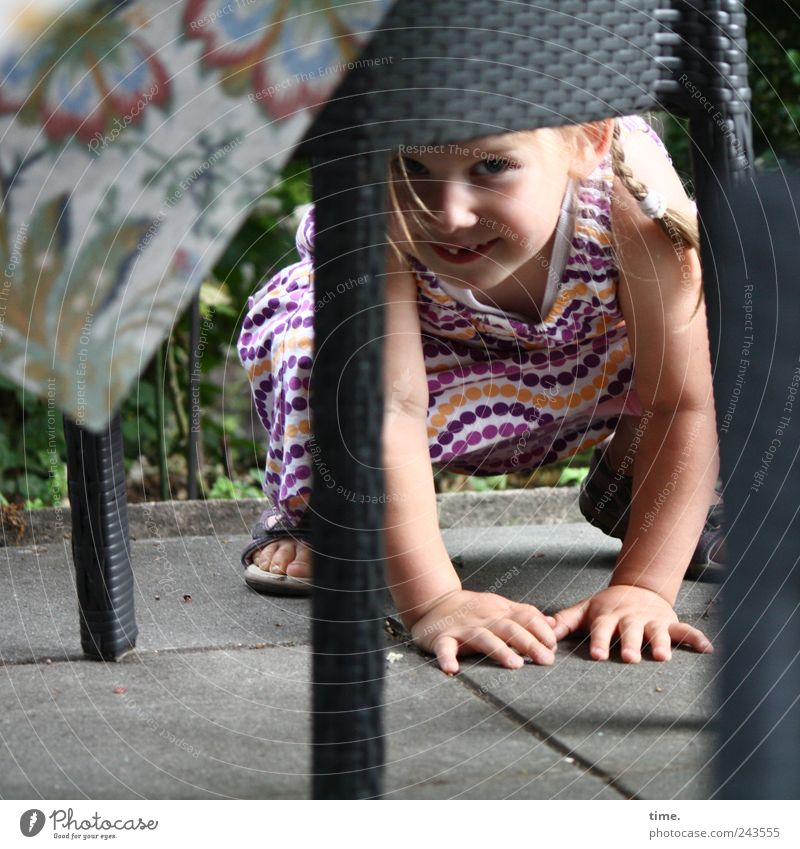 undercover Joy Playing Table Human being Girl Eyes Hand 1 1 - 3 years Toddler Blonde Observe Crouch table leg Rest on Colour photo Subdued colour Exterior shot