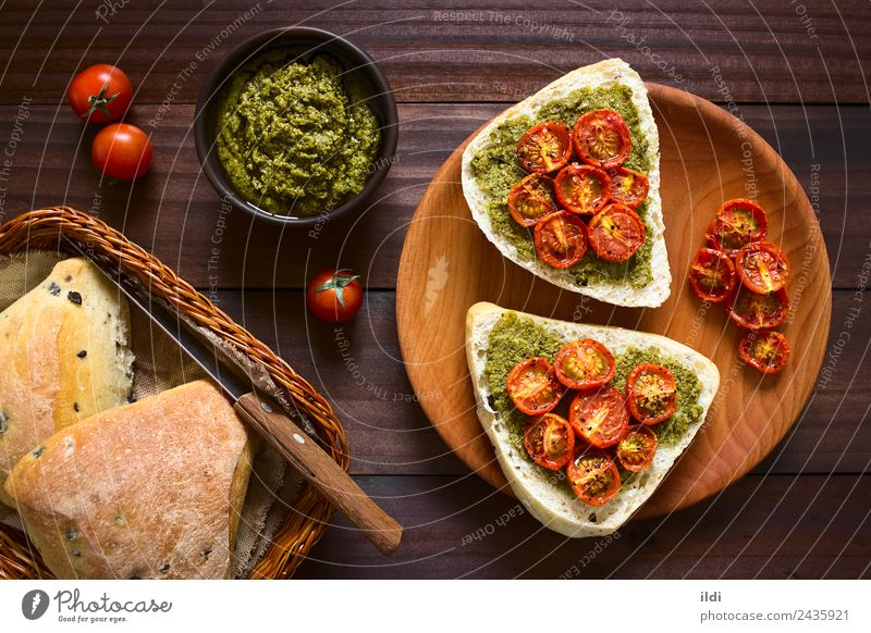Bread Roll with Pesto and Roasted Tomato Vegetable Breakfast Vegetarian diet Fresh food olive pesto roasted topping Spread Sauce Basil pepper Snack brunch
