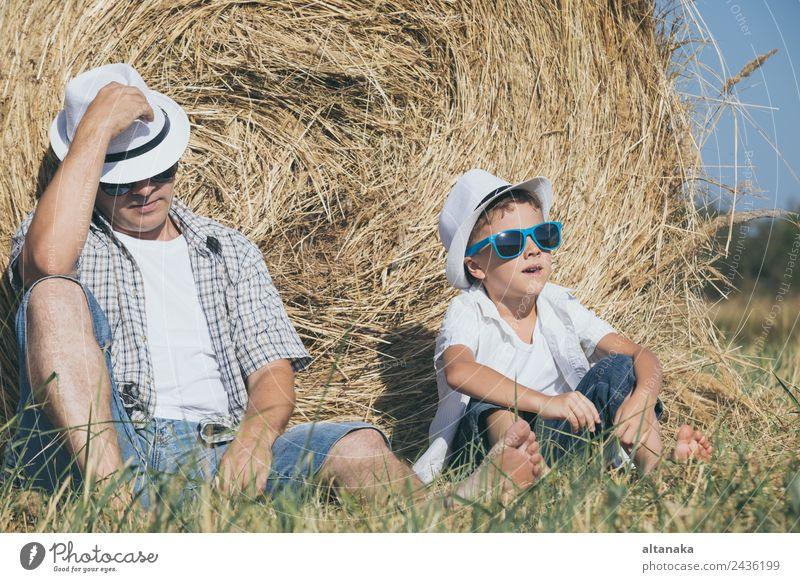 Father and son sitting in the park Child Human being Nature Vacation & Travel Man Summer Sun Joy Adults Lifestyle Love Sports Family & Relations Boy (child)