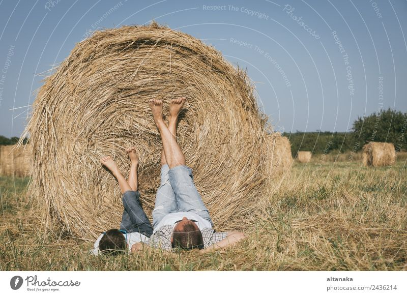 Father and son lying in the field Child Human being Nature Vacation & Travel Man Summer Sun Joy Adults Lifestyle Love Sports Family & Relations Boy (child)