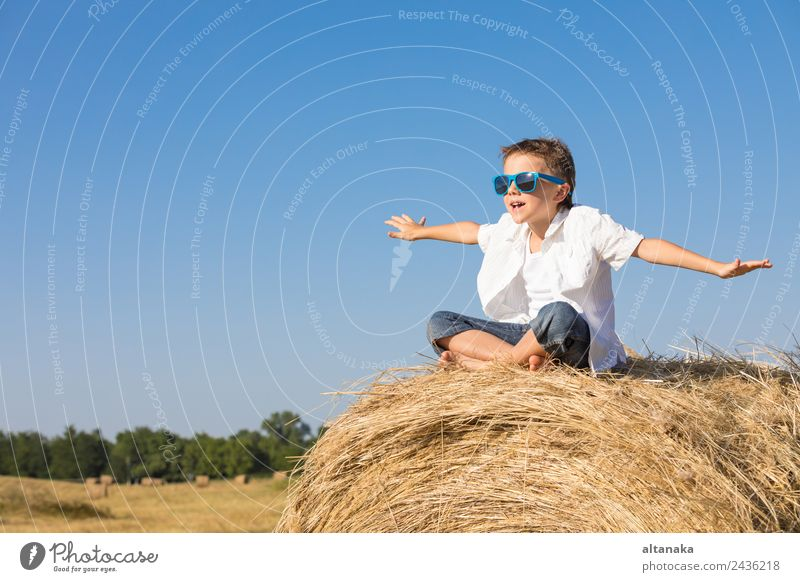 Happy little boy playing in the park Lifestyle Joy Beautiful Playing Vacation & Travel Freedom Summer Sports Success Child School Human being Boy (child) Man