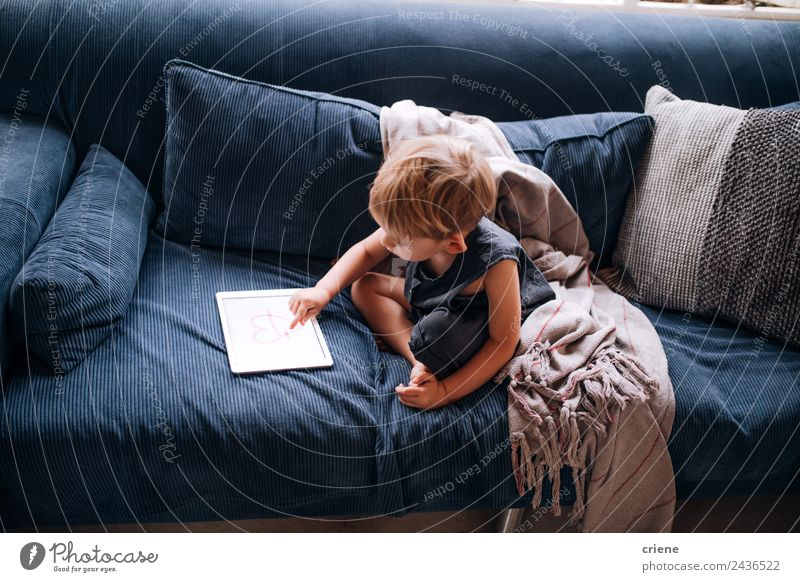 young caucasian little boy playing with tablet on couch Joy Beautiful Playing Sofa Living room Child Computer Screen Technology Toddler Boy (child) Infancy