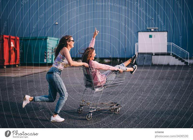 Young adult hipster friends having fun with shopping trolley Food Lifestyle Style Joy Happy Beautiful Summer Human being Woman Adults Friendship Warmth Fashion