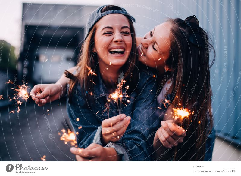 best friends enjoying time together with sparklers Lifestyle Joy Happy Beautiful Summer Feasts & Celebrations Woman Adults Friendship Hand Sunglasses Brunette