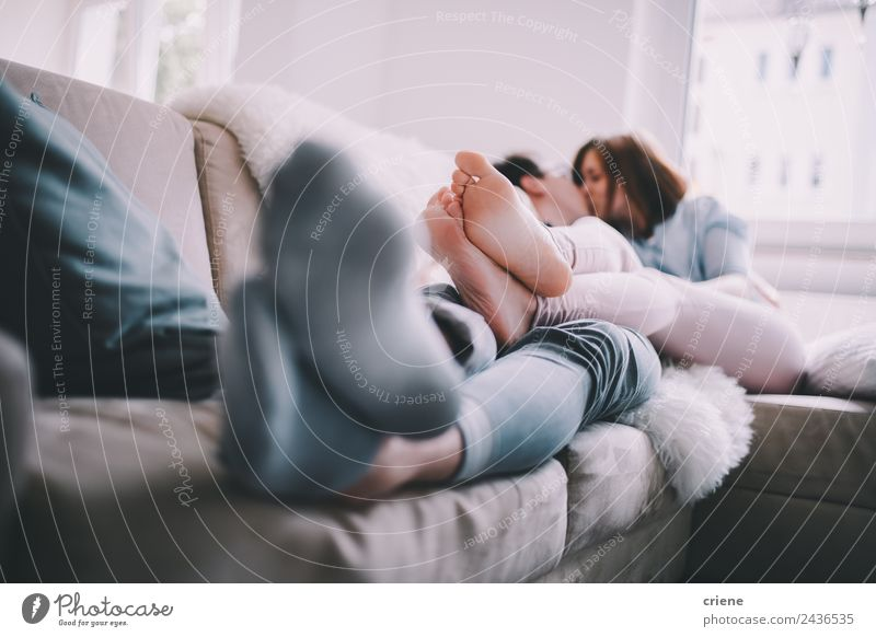Young adult couple kissing each other on couch Lifestyle Happy Beautiful Leisure and hobbies House (Residential Structure) Sofa Woman Adults Man Couple Kissing