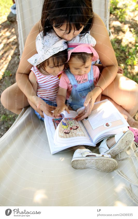 Reading stories Child Human being Adults Life Love Emotions Family & Relations Together Contentment Infancy Study Book Curiosity Protection Safety