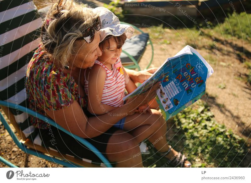 grandma reading a book to a child Lifestyle Leisure and hobbies Playing Children's game Parenting Education Adult Education Kindergarten School Student Teacher