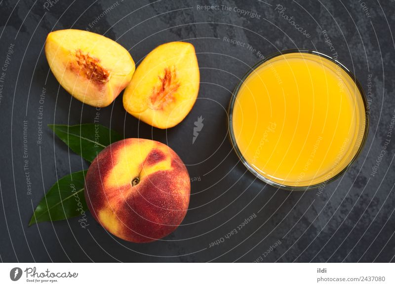 Peach Juice or Nectar Fruit Beverage Fresh food drink drupe Refreshment sweet glass Slate overhead Top Horizontal refreshing ripe top view natural light