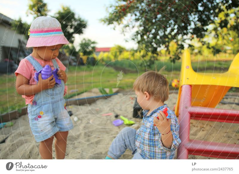 children playing in the sand, having a conversation over sand toys Playing Children's game Living or residing Parenting Education Kindergarten Office work