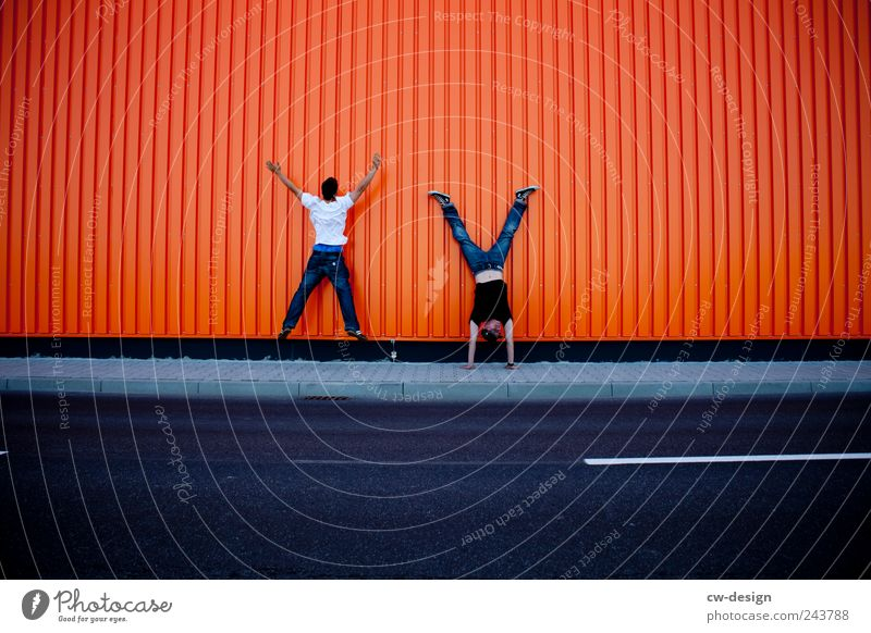 Human being Man Youth (Young adults) Joy Adults Street Wall (building) Playing Jump Wall (barrier) Friendship Funny Orange Leisure and hobbies Facade Masculine
