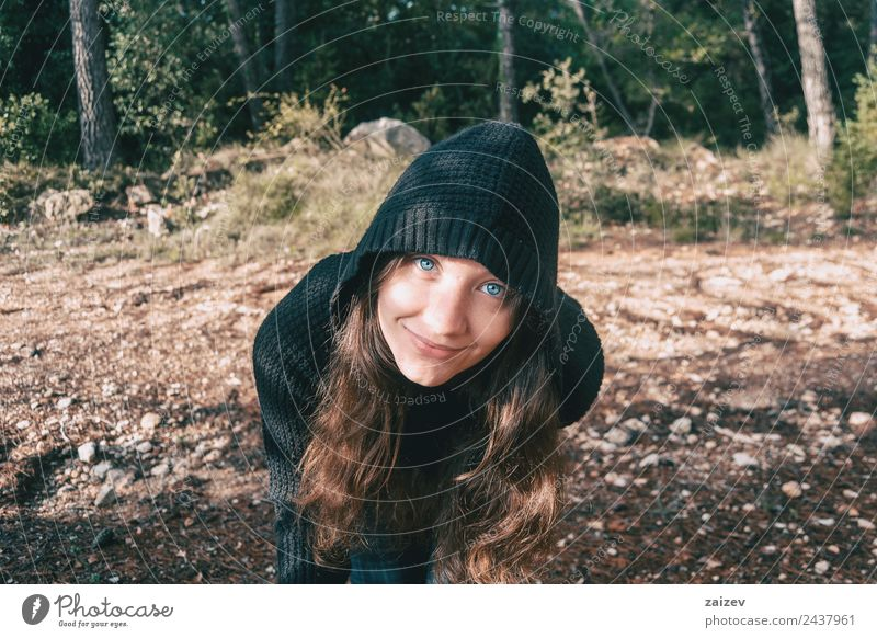 a girl with long hair and blue eyes in the mountains smiling with a hood Lifestyle Happy Beautiful Face Relaxation Freedom Mountain Human being Feminine