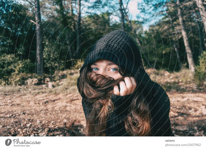 a girl with long hair and blue eyes in the mountain covering her face with her hair Lifestyle Elegant Style Happy Beautiful Face Relaxation Freedom Mountain