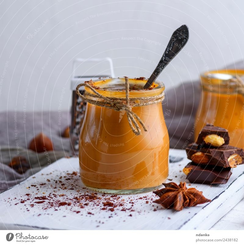 Caramel dessert Toffee Dessert Candy Spoon Table Wood Eating Delicious Brown Sauce background jar toffee pouring sweet Sugar Home-made food Sticky Syrup glass