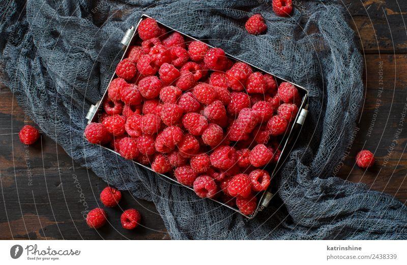 Fresh raspberries in a metal box Fruit Dessert Nutrition Breakfast Vegetarian diet Diet Summer Dark Natural Pink Red background Berries colorful Detox food