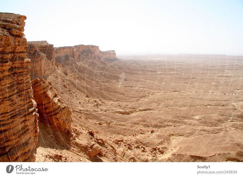 Edge of the world Saudi Arabia Nature Landscape Earth Sand Climate Drought Mountain Canyon Desert Looking Stand Old Far-off places Gigantic Infinity Hot Gloomy