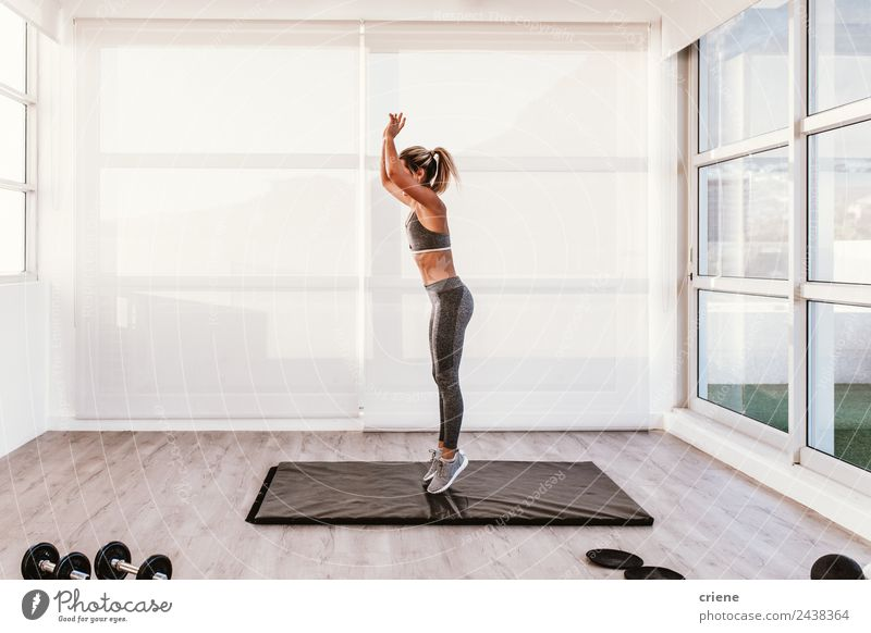 young caucasian woman doing fitness on mat at home Lifestyle Style Beautiful Body Wellness House (Residential Structure) Sports Woman Adults Fitness Jump