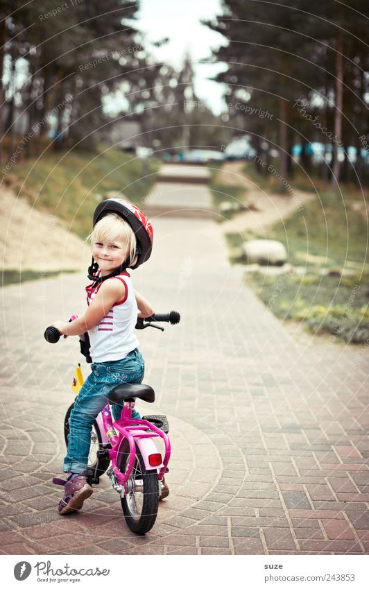 shoulder look Cycling Bicycle Child Human being Toddler Girl Infancy 1 3 - 8 years Tree Traffic infrastructure Lanes & trails Helmet Blonde Stand Wait Small
