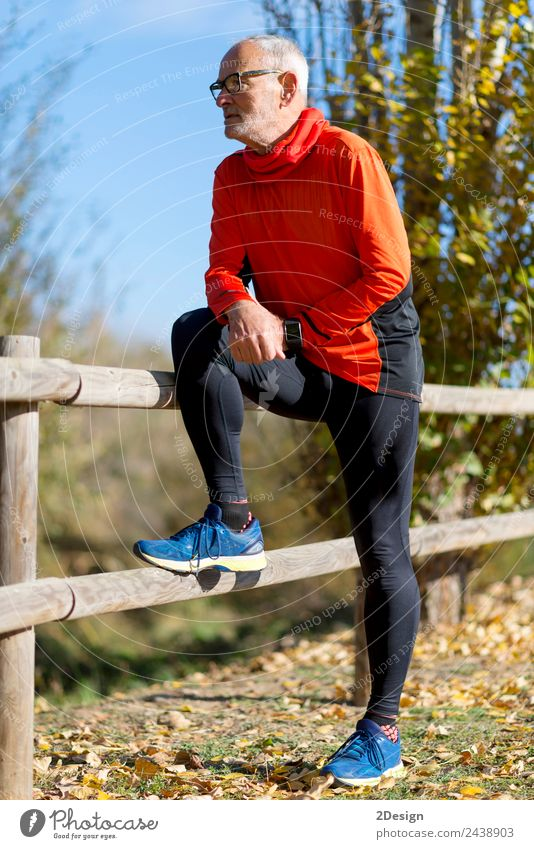 Full length Runner in red sportswear standing Lifestyle Joy Sports Sportsperson Jogging Retirement Human being Masculine Man Adults Male senior 1