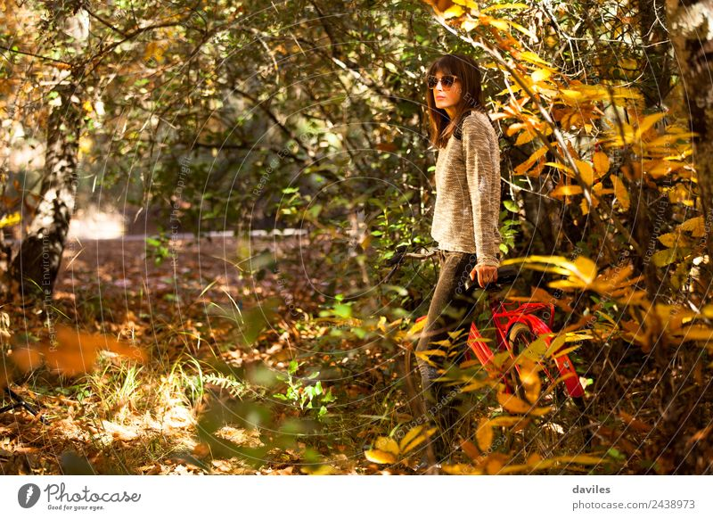 Woman with a bike in the middle of the forest. Lifestyle Happy Vacation & Travel Trip Garden Human being Young woman Youth (Young adults) 1 18 - 30 years Adults