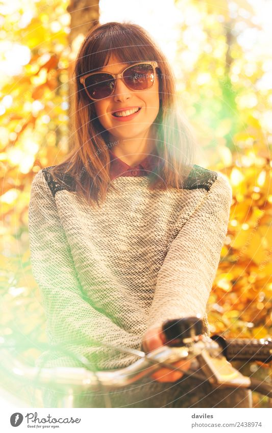 93730c0e66 Cute woman in sunglasses posing outdoors - a Royalty Free Stock Photo from  Photocase