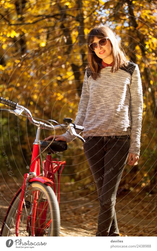 Young girl posing close to her bicycle. Woman Human being Nature Vacation & Travel Youth (Young adults) Young woman Red Forest 18 - 30 years Adults Lifestyle