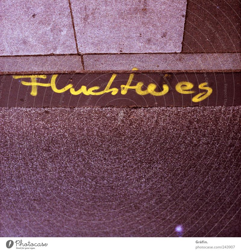 Yellow Street Graffiti Gray Brown Signs and labeling Concrete Characters Asphalt Sidewalk Footpath Escape Rescue Clue Attentive Lanes & trails
