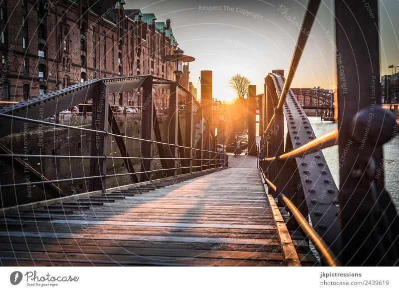 Old bridge in Hamburg Speicherstadt at sunset Twilight Evening Sunset Light Romance Brick Old warehouse district Germany World heritage Water Blue sky