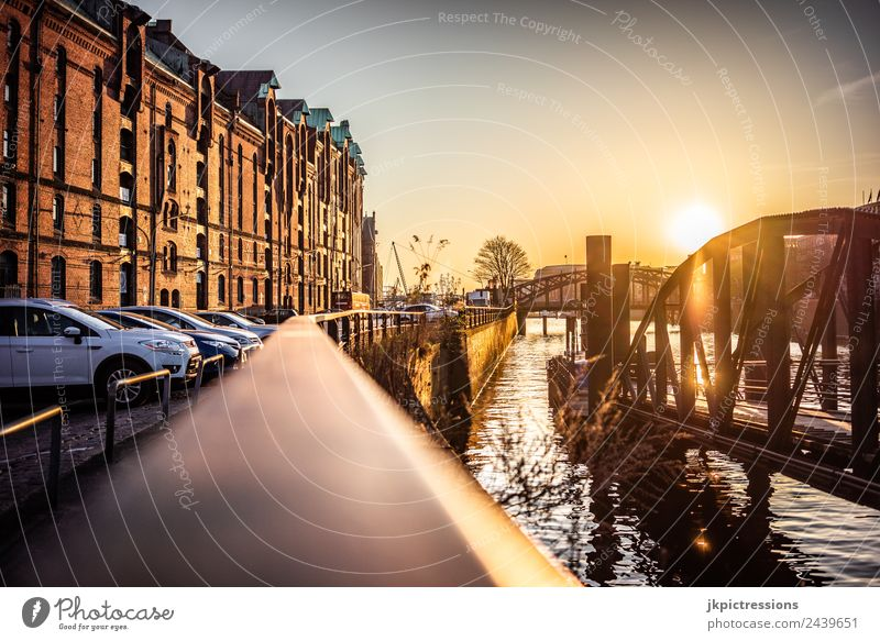 Railing in the Speicherstadt Hamburg Twilight Evening Sunset Light Romance Brick Old warehouse district Germany World heritage Water Blue sky Cloudless sky