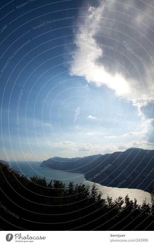 Nature Water Sky Sun Plant Clouds Far-off places Mountain Lake Landscape Air Fear Esthetic Bushes Climate Alps