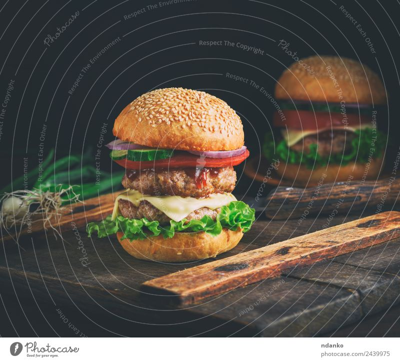 double cheeseburger Meat Cheese Vegetable Bread Roll Lunch Fast food Table Wood Eating Fresh Large Delicious Green Red Black Hamburger Beef BBQ fast Snack