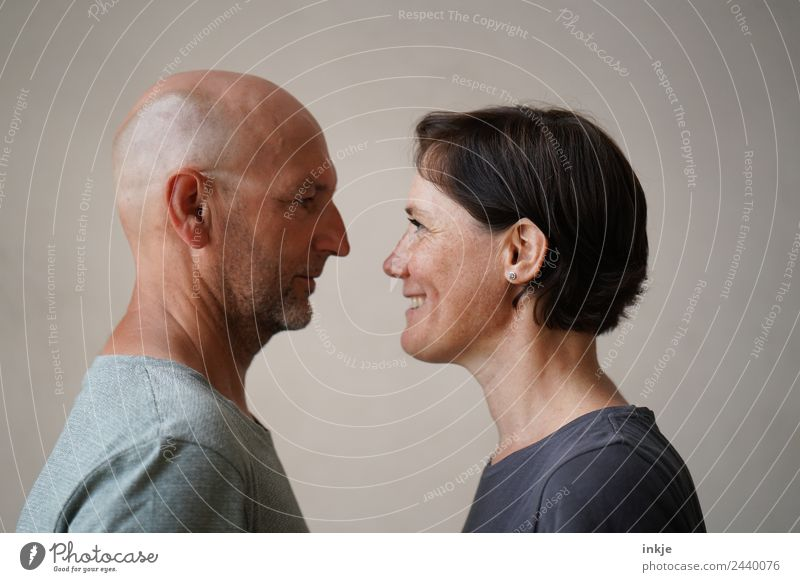 Man and woman face each other Woman Adults Friendship Couple Partner Life Face 2 Human being 30 - 45 years 45 - 60 years Smiling Laughter Looking Authentic