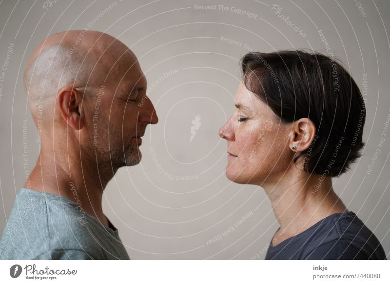 Man and woman face each other Lifestyle Leisure and hobbies Woman Adults Friendship Couple Partner Face 2 Human being 30 - 45 years 45 - 60 years Authentic