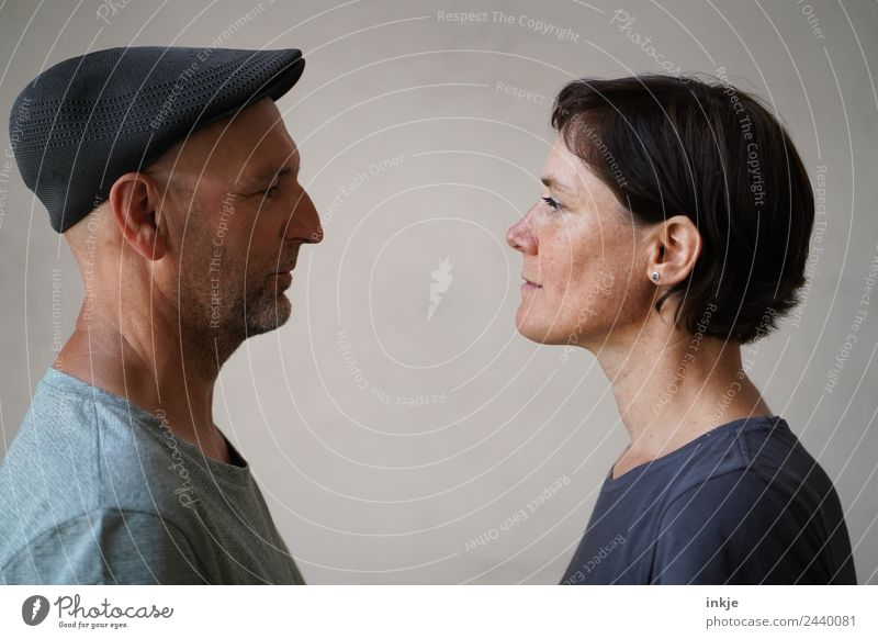 Man and woman face each other Together Attachment Woman Adults Looking Looking into the camera Face to face Bright background Profile portrait 2 Couple