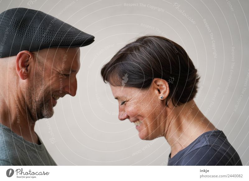 Couple faces each other and laughs Lifestyle Style Joy luck Harmonious Leisure and hobbies Woman Adults Man Friendship Partner Face 2 Human being 30 - 45 years