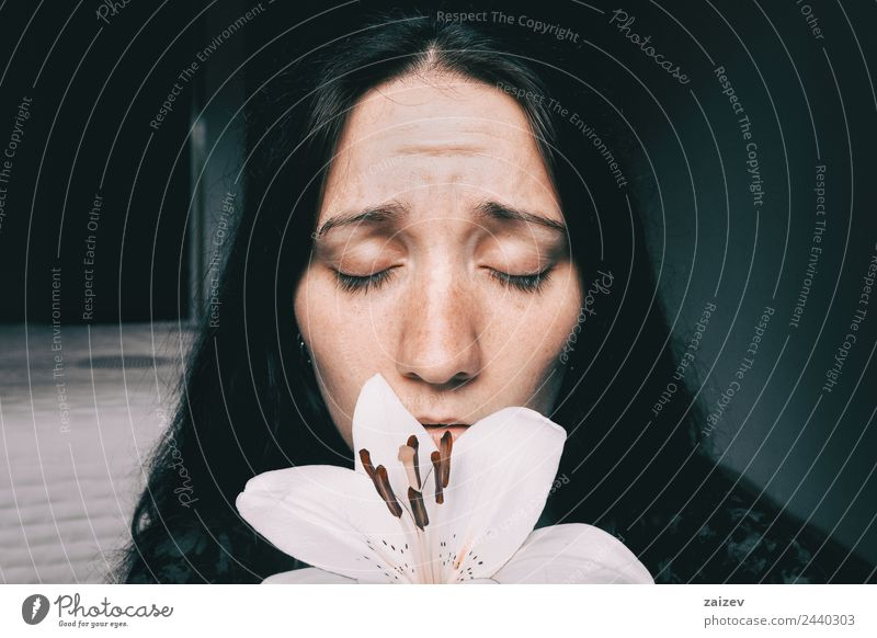a girl with a white lily and eyes closed worried Woman Human being Youth (Young adults) Young woman Plant Colour Beautiful White Flower Relaxation Loneliness