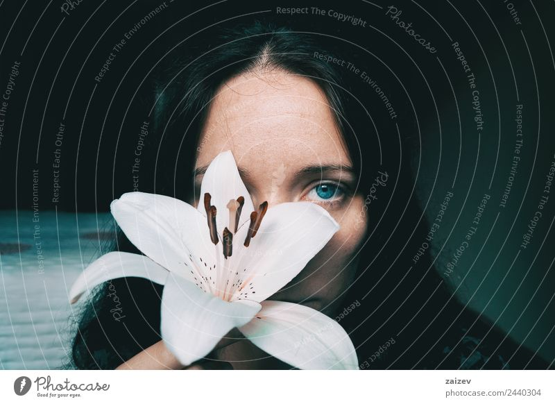 a girl with a white lily covering an eye Woman Human being Nature Youth (Young adults) Young woman Plant Colour Beautiful White Flower Relaxation Loneliness