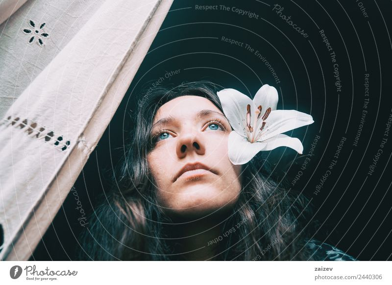 a girl with a white lily looking out the window Lifestyle Beautiful Face Relaxation Calm Human being Feminine Young woman Youth (Young adults) Woman Adults 1