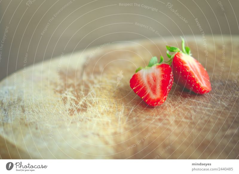 A sliced strawberry on a wooden board Fruit Strawberry Nutrition Vegetarian diet Fasting Wooden board Summer Kitchen Nature Plant Eating Fitness To enjoy